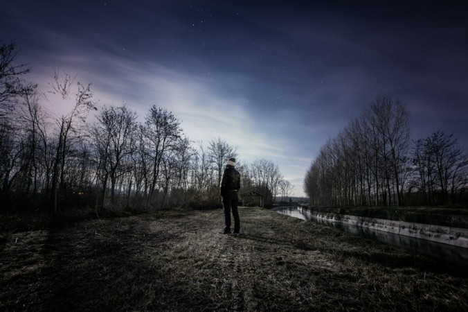 2-man-looking-at-landscape-at-night