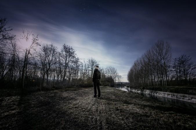 2-man-looking-at-landscape-at-night