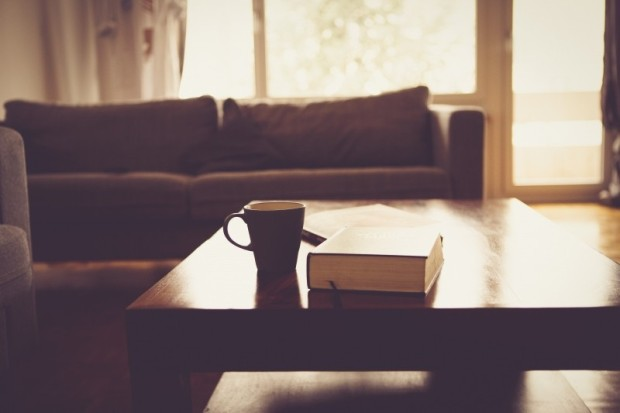 coffee-mug-and-book-on-table-in-living-room